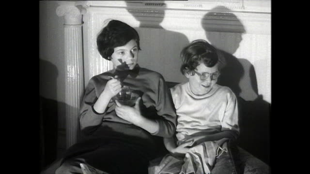 b&w children sit and watch television in the uk; 1958 - sister stock videos & royalty-free footage