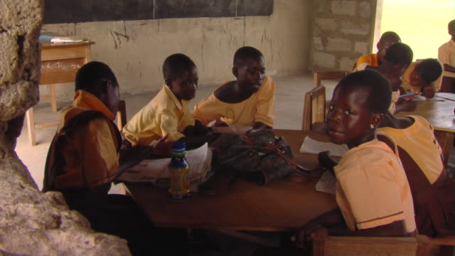 ms ha children sitting at table in classroom, tamale, ghana - ghana stock videos and b-roll footage