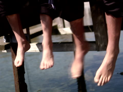 children sitting on a jetty sweden. - barefoot stock videos & royalty-free footage