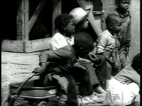 1939 ms children sitting on a wagon and one by one walking away / charleston, south carolina - separation stock videos & royalty-free footage