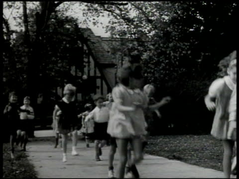 children skipping running on sidewalk children walking toward school door - running shorts stock videos & royalty-free footage