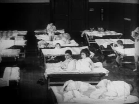 children sleeping on cots at nursery school / wpa project / newsreel - wpa stock videos & royalty-free footage