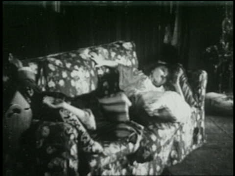 b/w 1925 2 children sleeping on couch waking up - 1925 stock videos & royalty-free footage