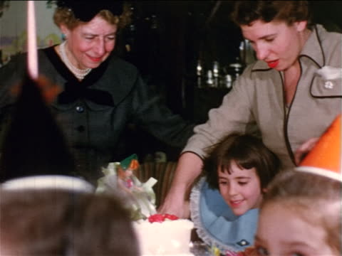 1954 home movie pan children smiling at birthday party - home movie stock videos & royalty-free footage