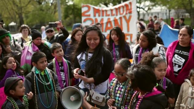 children speak about immigration reform near white house. children of immigrants march near the white house while calling for immigration reform... - reform stock-videos und b-roll-filmmaterial