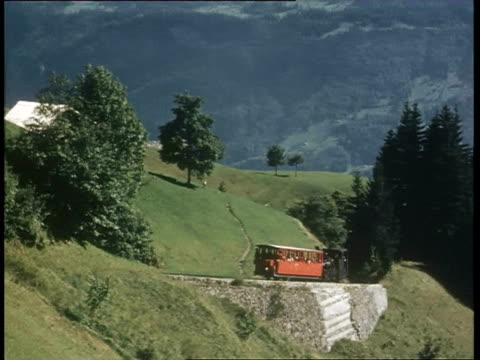 ms pov children speaking to station master and passenger looking out from train / achensee, tyrol, austria - オーストリア点の映像素材/bロール