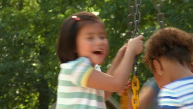 cu tu children spinning on playground tire swing/ td children/ richmond, virginia - tire swing stock videos & royalty-free footage