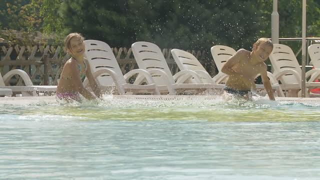 HD SLOW MOTION: Children Splashing Each Others