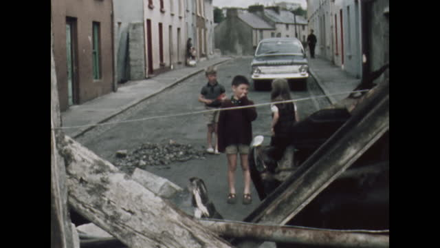 children stand behind a street barricade in the bogside district of londonderry, northern ireland, prior to the apprentice boys parade; 1969. - boundary stock videos & royalty-free footage