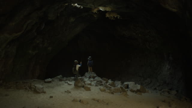 children stand in a cave - sibling stock videos and b-roll footage