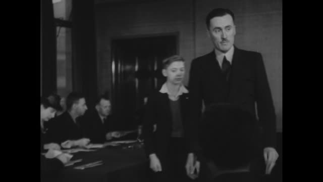 montage children stand trial in juvenile court / dundee, scotland, united kingdom - anno 1944 video stock e b–roll