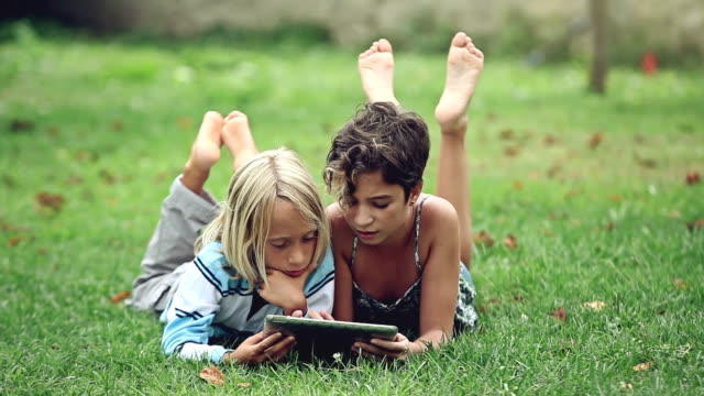 children studying and playing on a tablet - sister stock videos & royalty-free footage