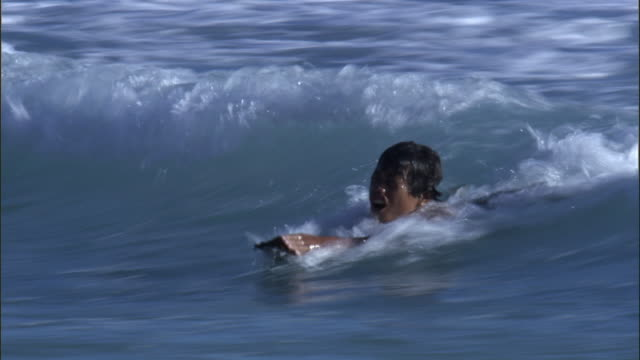 children surf on wooden paddles, anuta, solomon islands - pacific islands stock videos & royalty-free footage