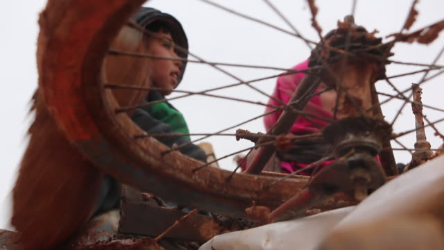 children surviving on the turkey syria border shows: children riding bike and getting on truck, interview with raghad, interviews with abdulrahman,... - survival stock videos & royalty-free footage