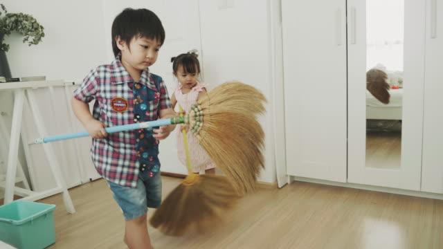 children sweeping floor - sweeping stock videos & royalty-free footage