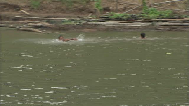 Children swimming in the Mekong: Long Shot.