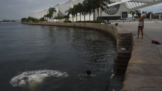 children swimming in the port of the rio de janeiro brazil on august 15 2020 tourist attractions reopened this week after being shut for five months... - after life stock videos & royalty-free footage
