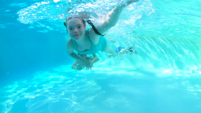 children swimming underwater, girl with down syndrome - 10 11 years stock videos & royalty-free footage