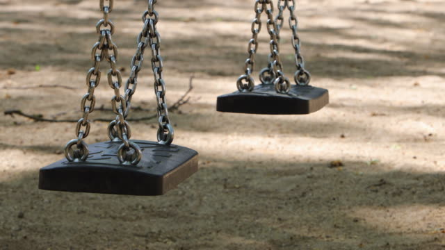 children swing empty at german park - missing people stock videos & royalty-free footage
