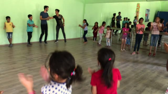 Children take part in a dance workshop at the Istasyon Sirkhane Center on July 24 2018 in Mardin Turkey The circus school or Her Yerde Sanat...