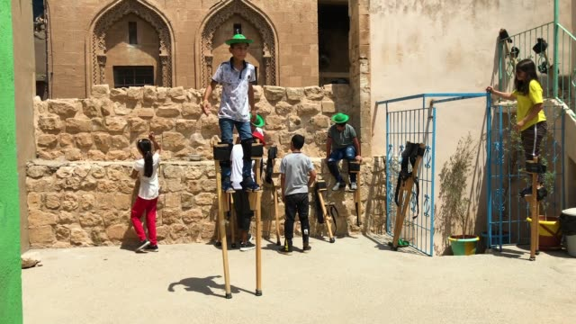 children take part in a stilt workshop at the mardin sirkhane center on july 23 2018 in mardin turkey the circus school or her yerde sanat translated... - stilts stock videos and b-roll footage