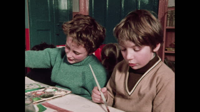 children talk to each other whilst working, 1970s - drawing activity stock videos & royalty-free footage