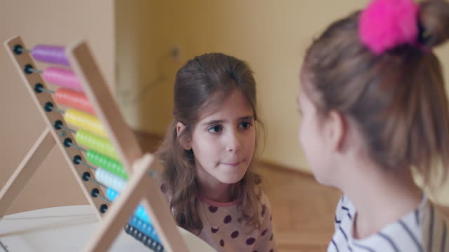 Children talking about abacus