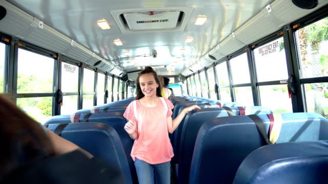 children, teacher, boy with downs boarding school bus - sitting stock videos & royalty-free footage