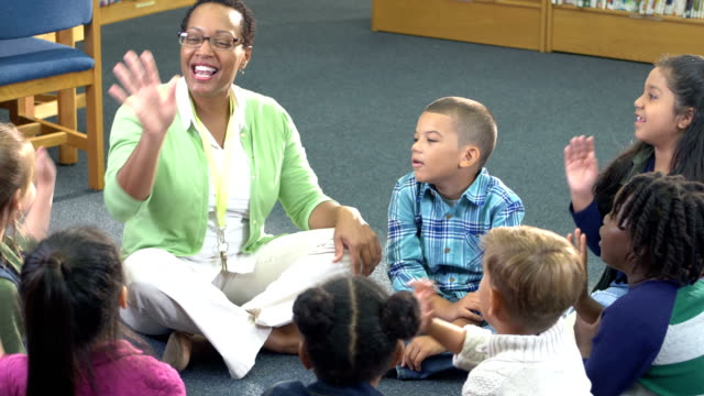 children, teacher sitting in circle talking and laughing - 6 7 years stock videos & royalty-free footage