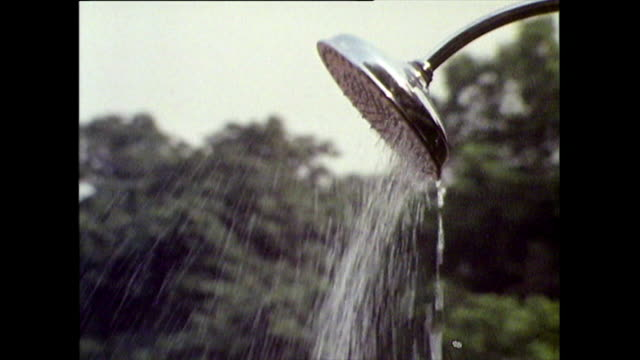 children use shower at serpentine lido in hyde park; 1971 - semi dress stock videos & royalty-free footage