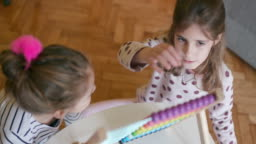Children using abacus, slow motion, handheld shot, high angle view