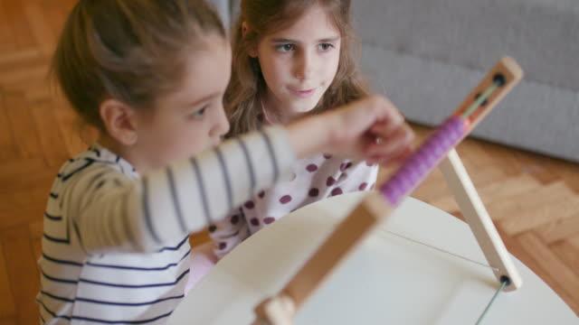 Children using abacus, slow motion, handheld shot