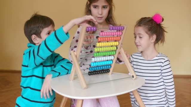 Children using abacus, slow motion