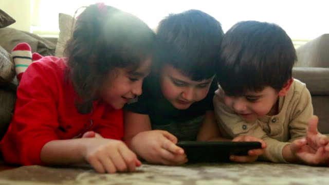 children using digital tablet together in living room - preschool student stock videos and b-roll footage