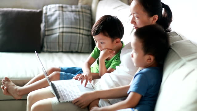 children using laptop - chinese ethnicity stock videos and b-roll footage