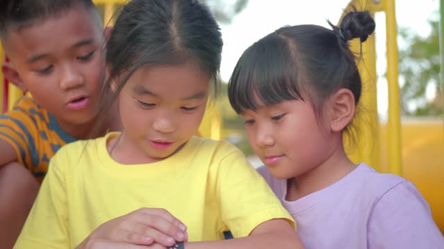 children using smart watch at playground. - 3g stock videos & royalty-free footage
