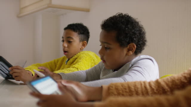 3 children using their digital tablets - brother stock-videos und b-roll-filmmaterial