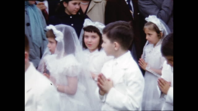 children walk as a group to get their first communion. - unschuld stock-videos und b-roll-filmmaterial