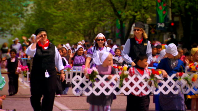 children walking in the kinder parade with picket fence pieces and flowers - picket fence stock videos & royalty-free footage