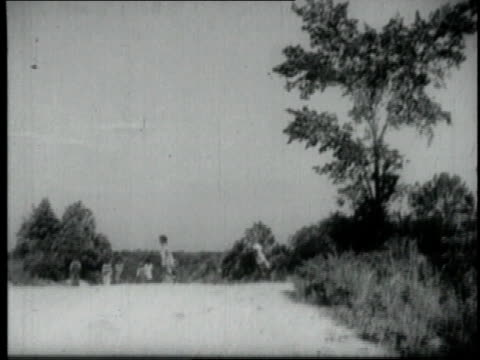 1940 ls children walking into a poor country school house / united states - boys stock videos & royalty-free footage