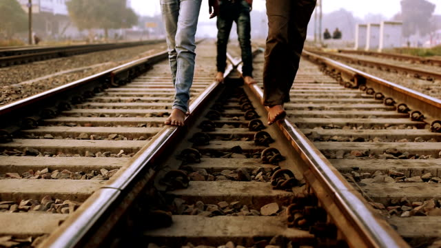 children walking on train track - stepping stock videos & royalty-free footage