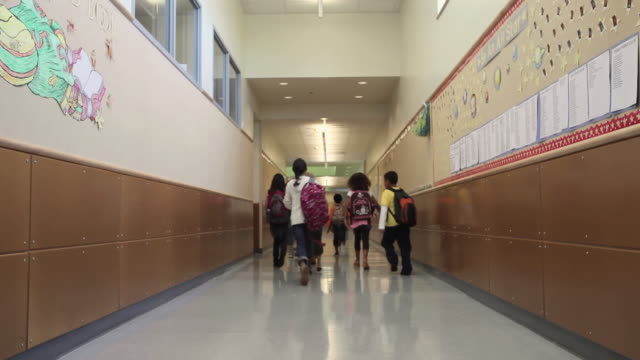 WS Children (8-11) walking through corridor of elementary school / University Place, Washington, USA