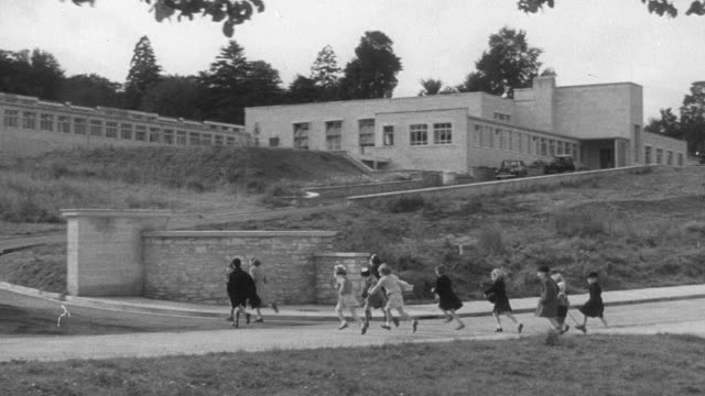 1951 montage children walking to a neighborhood school / united kingdom - 1951 stock videos & royalty-free footage
