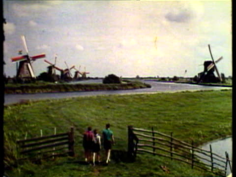vídeos de stock e filmes b-roll de 1953 ws children walking towards windmills / brussels, belgium / audio  - menos de 10 segundos