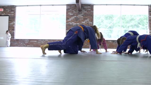Children warming up for Jiu-jitsu class