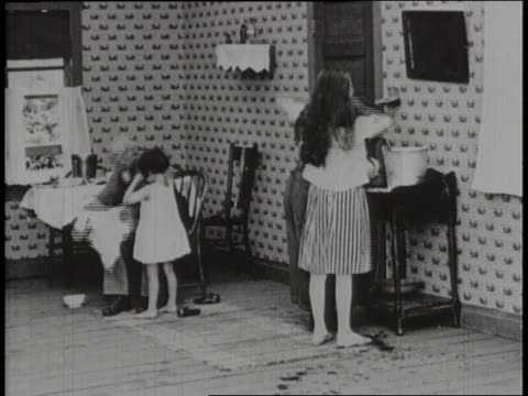 children wash up for breakfast as a mother prepares the meal - gender stereotypes stock videos & royalty-free footage