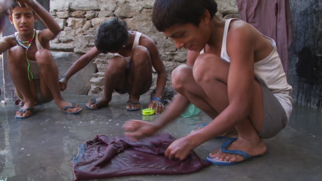 children washing clothes - orphan stock videos & royalty-free footage