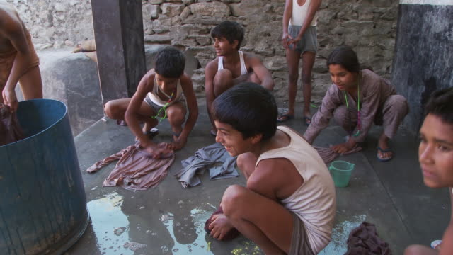 children washing clothes - orphan stock videos and b-roll footage