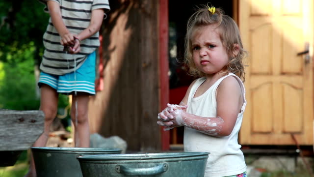 children washing clothing in the backyard - rubbing stock videos & royalty-free footage