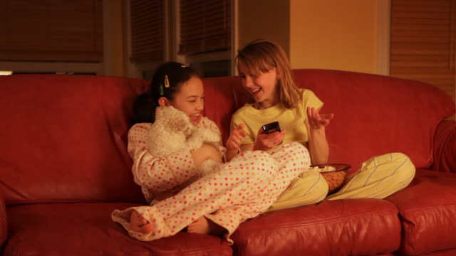 children watching television with pet  dog - little girls bare feet stock videos and b-roll footage